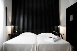 Een bed of bedden in een kamer bij Hotel Market