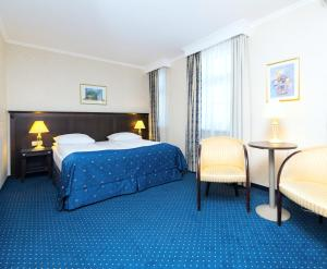 A bed or beds in a room at Rixwell Gertrude Hotel