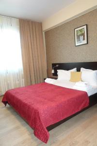 Un pat sau paturi într-o cameră la Hotel Nord