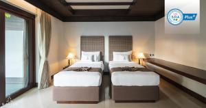 A bed or beds in a room at Malisa Villa's Kata