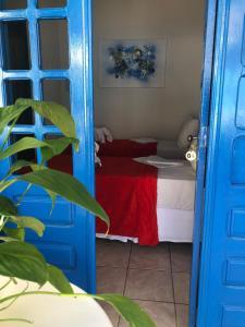 Cama ou camas em um quarto em Pousada Cantinho do Porto