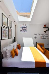 A bed or beds in a room at Oscar Hotel by Atlas Studios