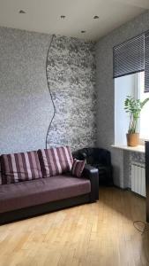 A seating area at Двухкомнатные апартаменты на Кутузовском