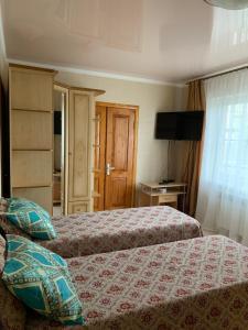 Кровать или кровати в номере Бухточка