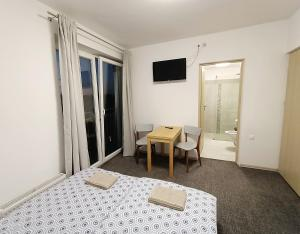 A bed or beds in a room at Firstroom Gdańsk