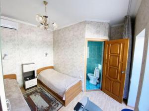Кровать или кровати в номере Гостевой Дом «На Самбурова 279»
