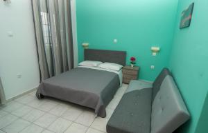 Ένα ή περισσότερα κρεβάτια σε δωμάτιο στο Ampelaki Studios