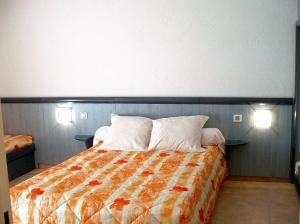 Un ou plusieurs lits dans un hébergement de l'établissement Village Vacances Passion La Grande Bastide