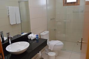 Um banheiro em Sky Ville Hotel Gramado