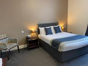 A bed or beds in a room at Cumbria Park Hotel