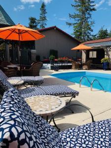 The swimming pool at or near Coachman Inn Oak Harbor