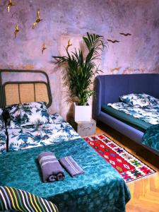 A bed or beds in a room at Pokoje przy plaży