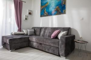 A seating area at Hortenzija Apartments