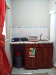 A kitchen or kitchenette at Home Away From Home