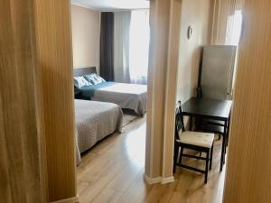 Кровать или кровати в номере Апартаменты у метро Красный проспект
