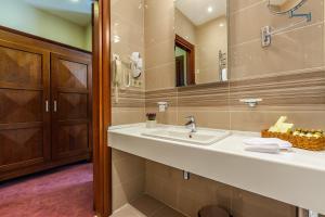 Ванная комната в Отель Райкин Плаза