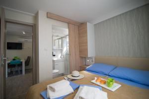 Een bed of bedden in een kamer bij Centinera Resort