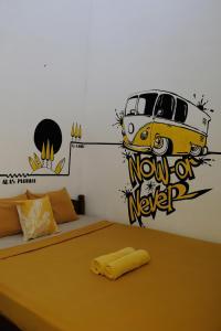 Een bed of bedden in een kamer bij Banana Homestay