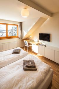 Кровать или кровати в номере Lisensky Dvur