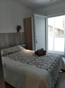 A bed or beds in a room at Tequeron