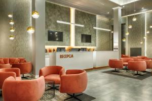 The lobby or reception area at Grand Focus Hotel Szczecin