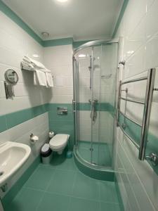 Ванная комната в Irbis Hotel