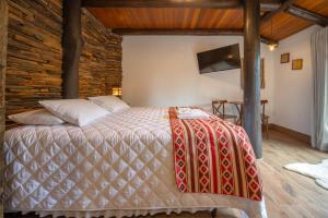 A bed or beds in a room at Aires de Patagonia