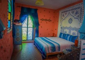 A bed or beds in a room at Dar Touijar