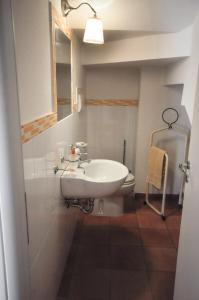 A bathroom at CASA VACANZE AGAVE