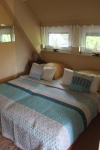 Ein Bett oder Betten in einem Zimmer der Unterkunft Apartments Domicil Alice