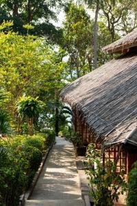 A garden outside Baan Krating Phuket Resort