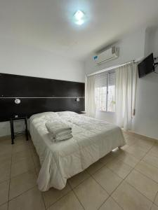A bed or beds in a room at Apart Bahia
