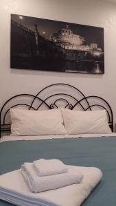 Un ou plusieurs lits dans un hébergement de l'établissement L'Oasi al Pigneto - Guest house
