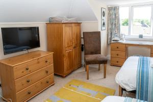 Телевизор и/или развлекательный центр в Stour Lodge Guest House