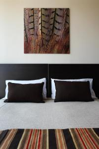 A bed or beds in a room at Niyat Urban Hotel