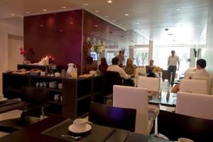 A restaurant or other place to eat at Niyat Urban Hotel