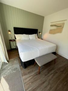 A bed or beds in a room at Waterton Glacier Suites