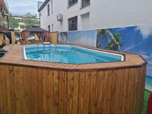 The swimming pool at or near Legenda Guest House