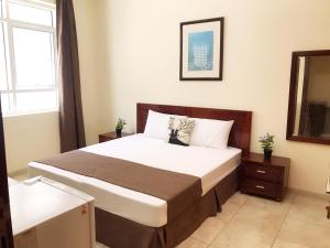 Master Bedroom with Attached Washroom near to M.O.E. Metro Station.
