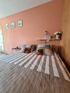 A bed or beds in a room at Ausekla Street Holiday Home