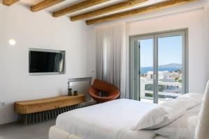 A television and/or entertainment center at Splendid Mykonos Luxury Villas & Suites