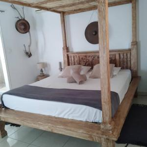 A bed or beds in a room at Villa mimosa
