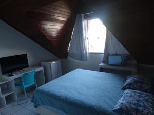 A bed or beds in a room at Recanto dos Pássaros