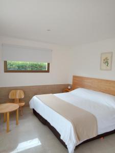 Una cama o camas en una habitación de Chacras de Sierra