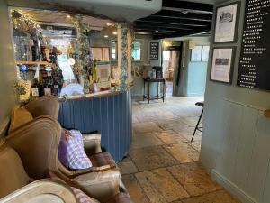 The lobby or reception area at The Windmill Inn
