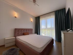 A bed or beds in a room at Adora Forest