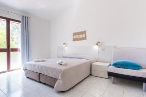 A bed or beds in a room at Residence Cort'e Accas