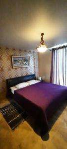 Кровать или кровати в номере Sportivno-turisticheskaya baza Oshten