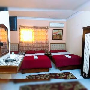 A bed or beds in a room at New Palace Hotel