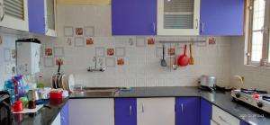 A kitchen or kitchenette at CHIRAG HOME STAY - A Tranquil Bliss